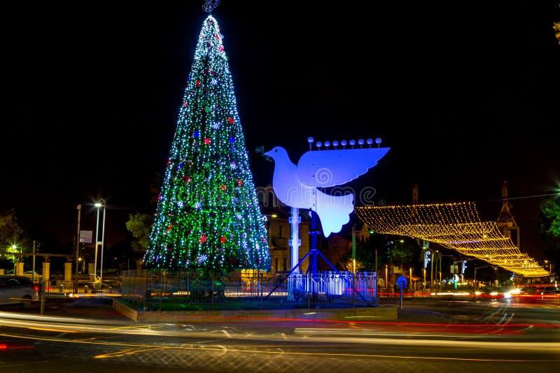 Christmas tree and Hanukkah menorah in Haifa stock image