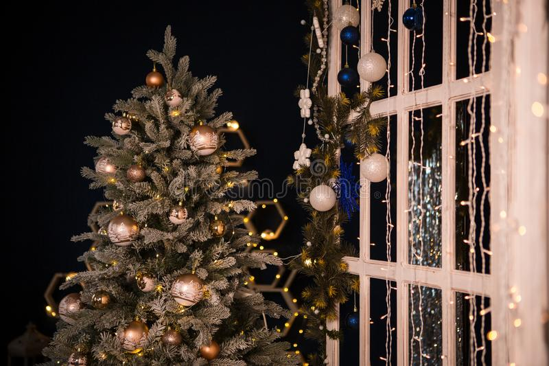 Christmas tree holiday home interior lights garlands, and home decorations. stock photos
