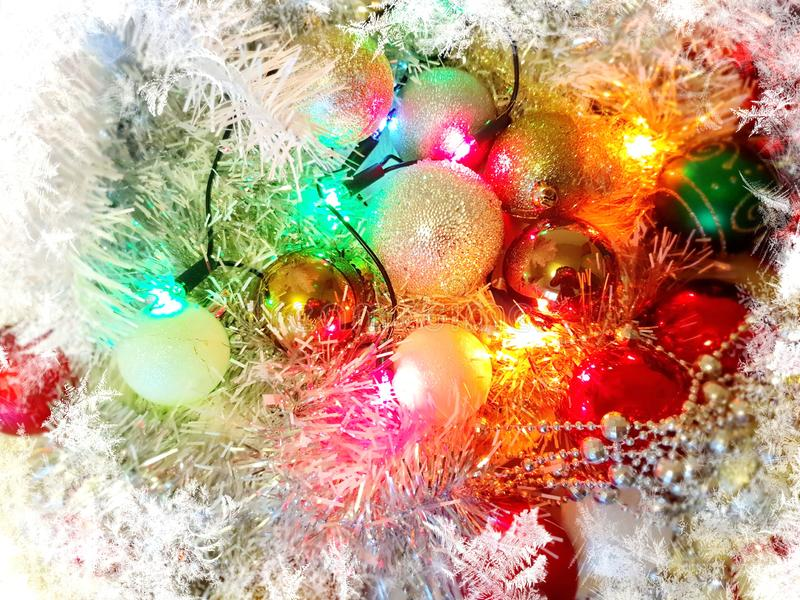 Christmas tree holiday white gold silver red green balls with snowflakes wallpaper light decoration lights colorful new year blurr. Christmas tree holiday white royalty free stock photo