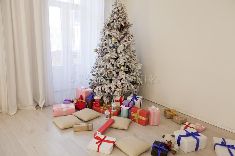 Christmas tree in the Interior of the white room gifts new year holiday royalty free stock photography