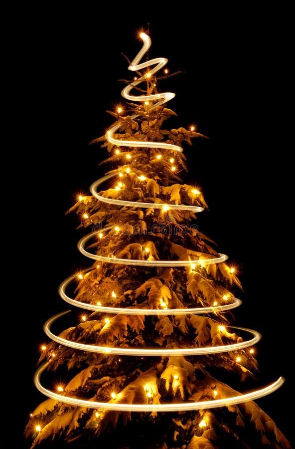 Christmas tree with light spiral drawn around it stock