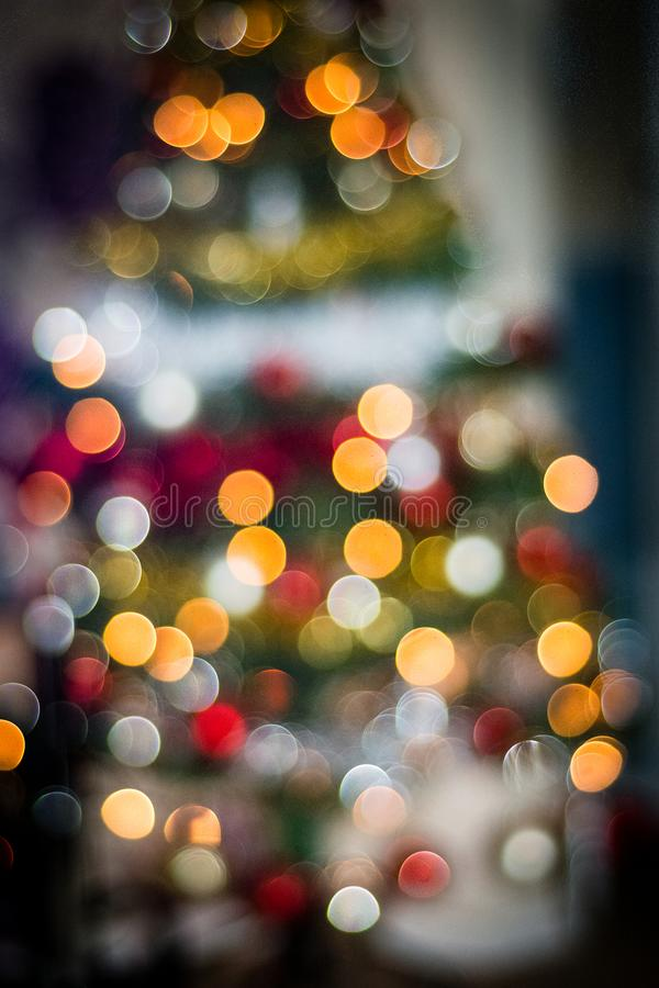 Christmas Tree Lights and Decorations with Blurred Out of Focus lights creating Bokeh. Colorful Red, Yellow and Green Christmas Tree.  The lights are  de focused stock photo