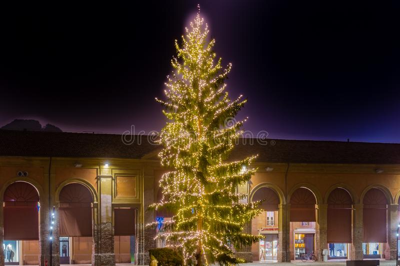Christmas tree. Lights of christmas tree in old portico at night stock photo