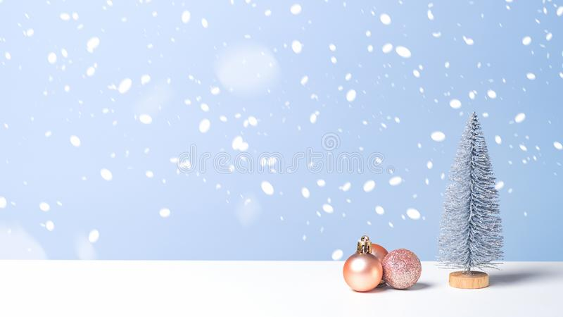 Christmas tree and little balls decoration ornaments on blue background. Christmas banner with copy space, New Year greeting card stock photo