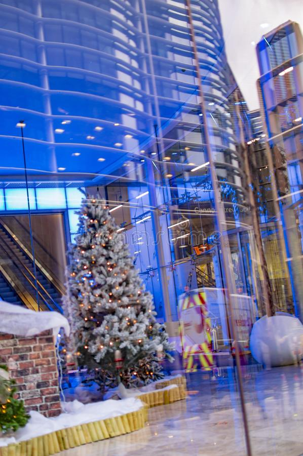 Christmas tree london decorated inside the blue building. In uk stock photography