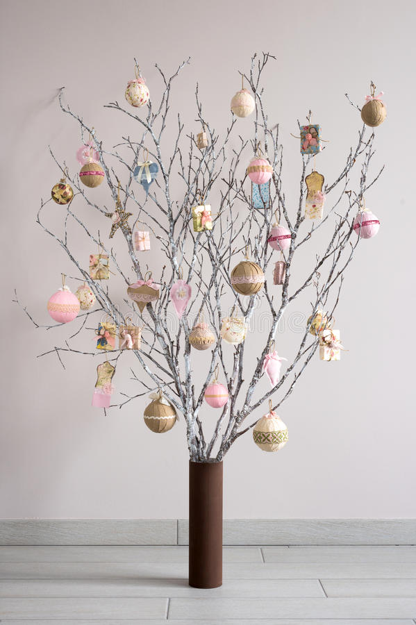 Christmas tree made from branches and vintage balls and decoration. Alternative Christmas tree royalty free stock photos