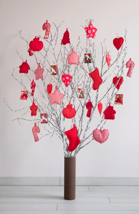 Christmas tree made from branches and vintage balls and decoration. Alternative Christmas tree stock image