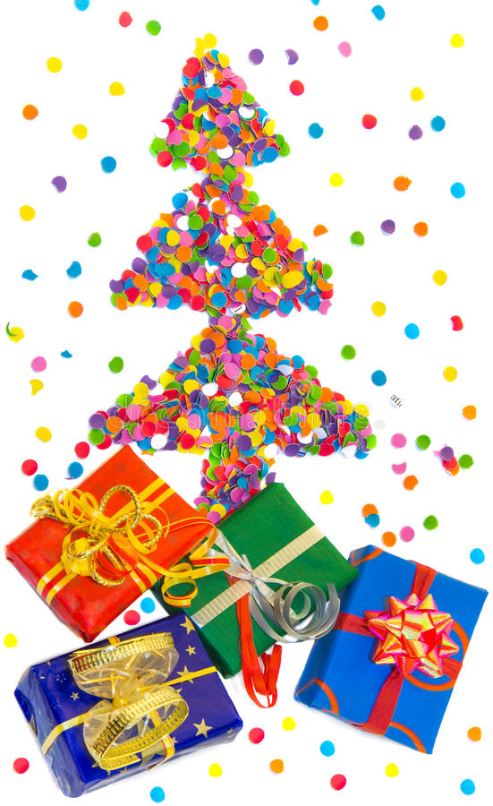 Christmas tree made of confetti with colorful gift boxes. stock photography