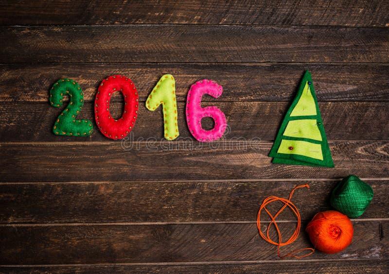 2016 Christmas tree made of felt. Childish New year background. royalty free stock images