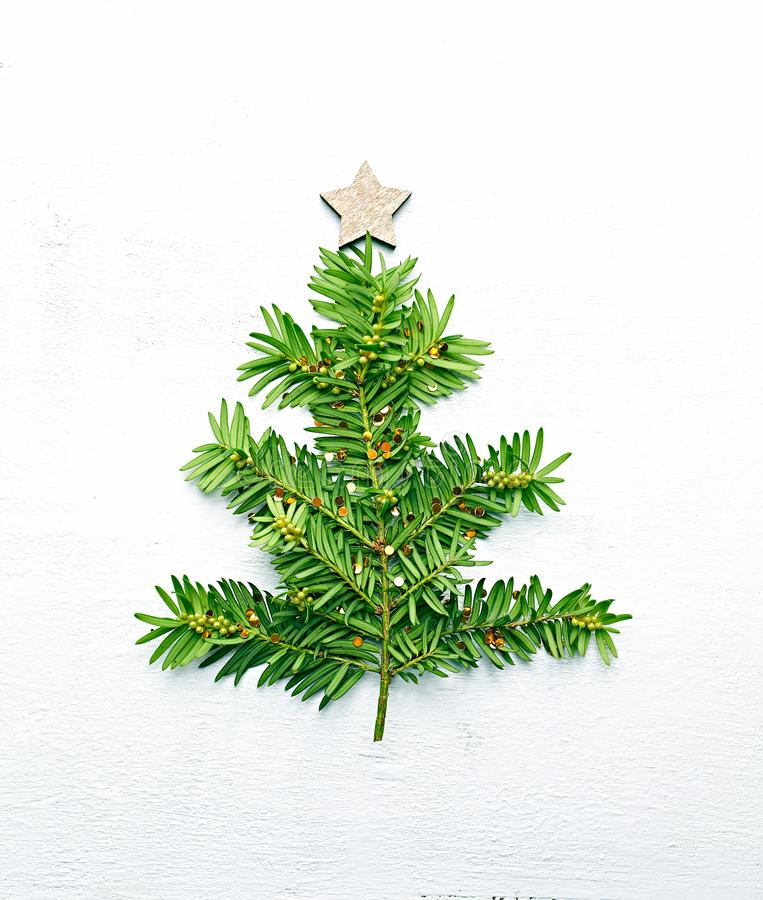 Christmas tree made from fir twigs and decorated with golden glitter. Christmas symbol royalty free stock photo