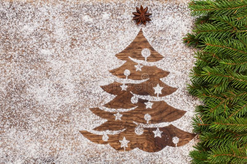 Christmas tree made of flour on wooden surface. Seasonal and holidays decoration with fir branches and copy space vector illustration