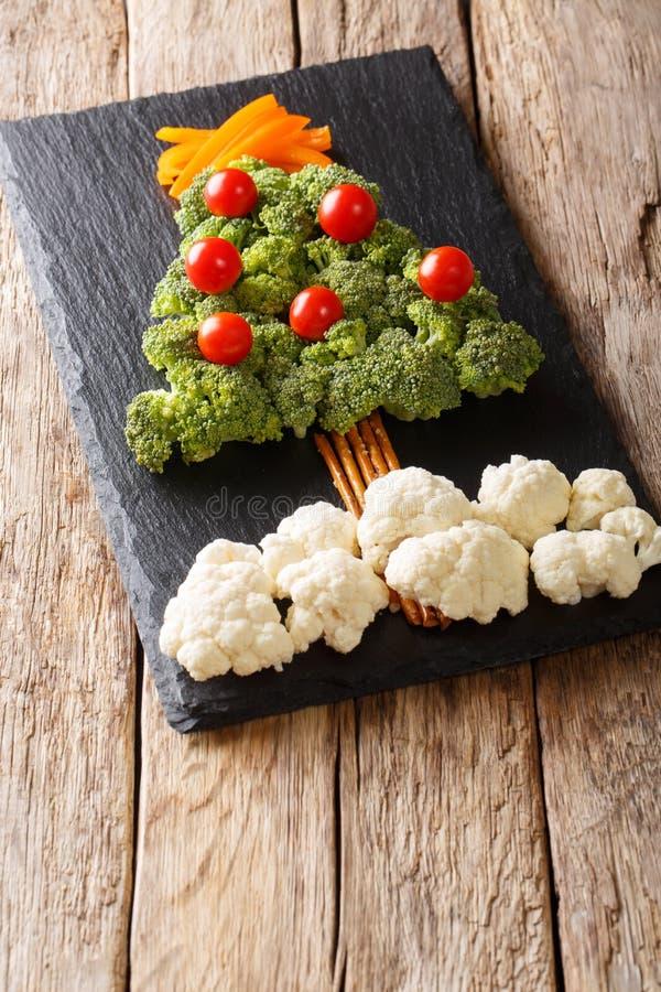 Christmas tree made of fresh vegetables broccoli, cauliflower, t stock photo