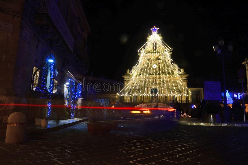 Christmas tree made of gold colored lights that covers the entire facade of the church of San Sebastiano di Palazzolo Acreide. Siciliy stock images