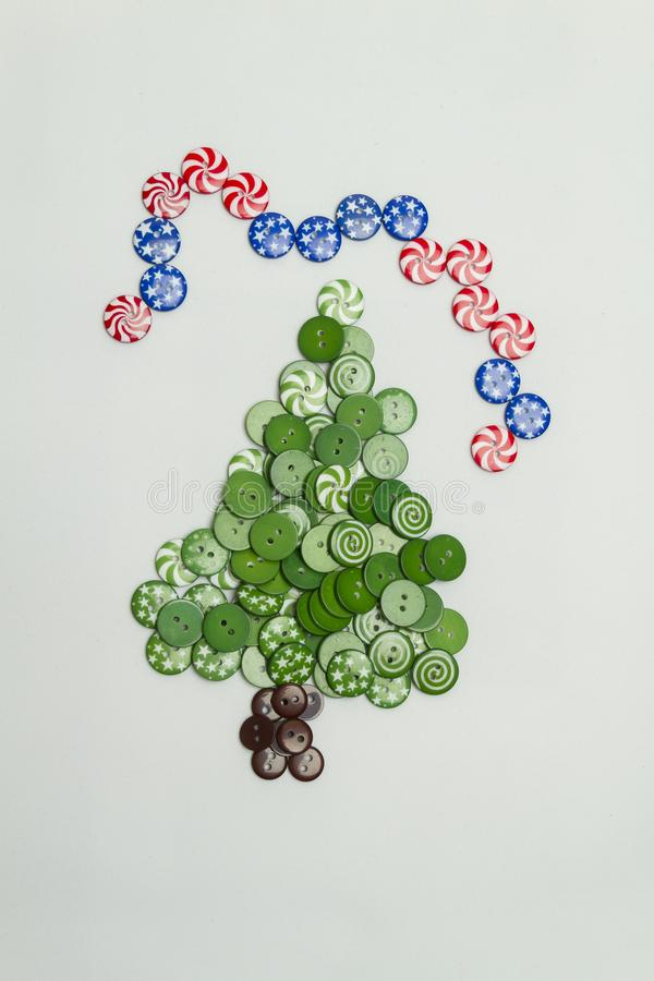 Christmas tree made with colorful buttons and american flag on white background royalty free stock image