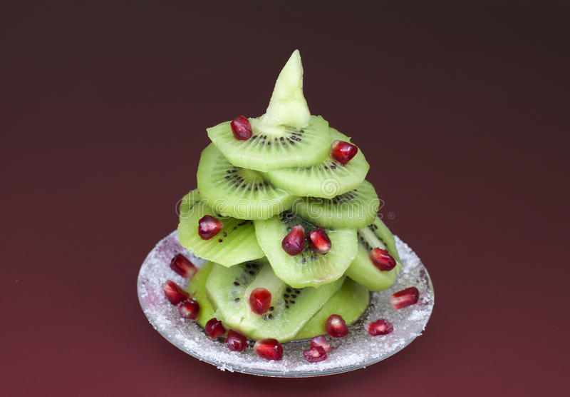 Christmas tree made of kiwi stock image