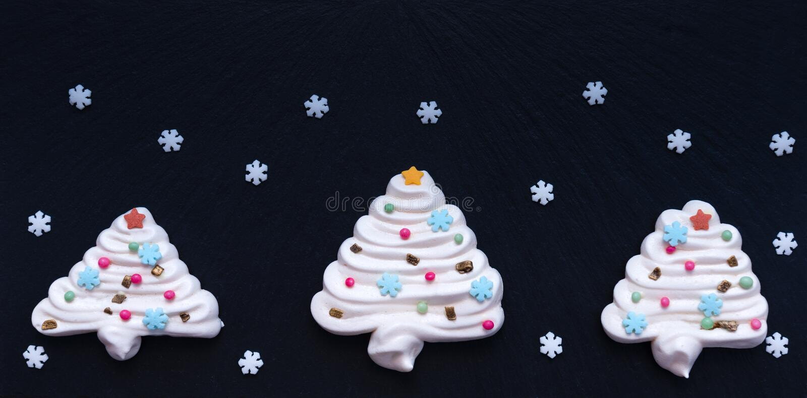 Christmas tree made by meringue with white snowflackes royalty free stock images