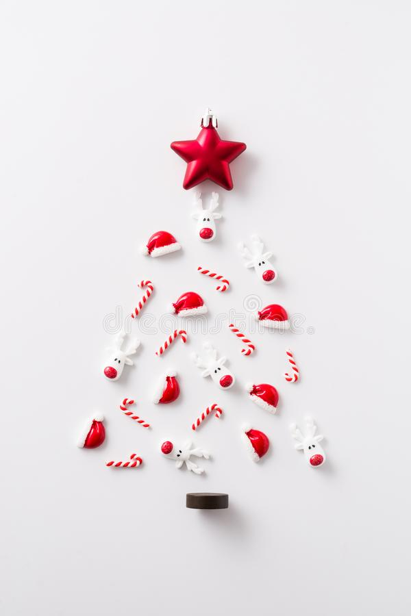 Christmas tree made with Christmas ornaments on white background. Top viewn royalty free stock photography