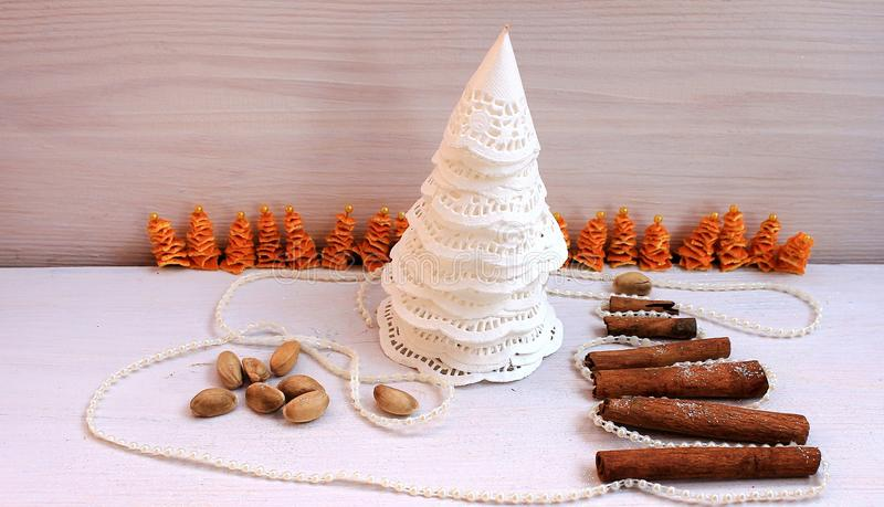 Christmas tree made of paper, cinnamon, pistachio New Year composition royalty free stock image