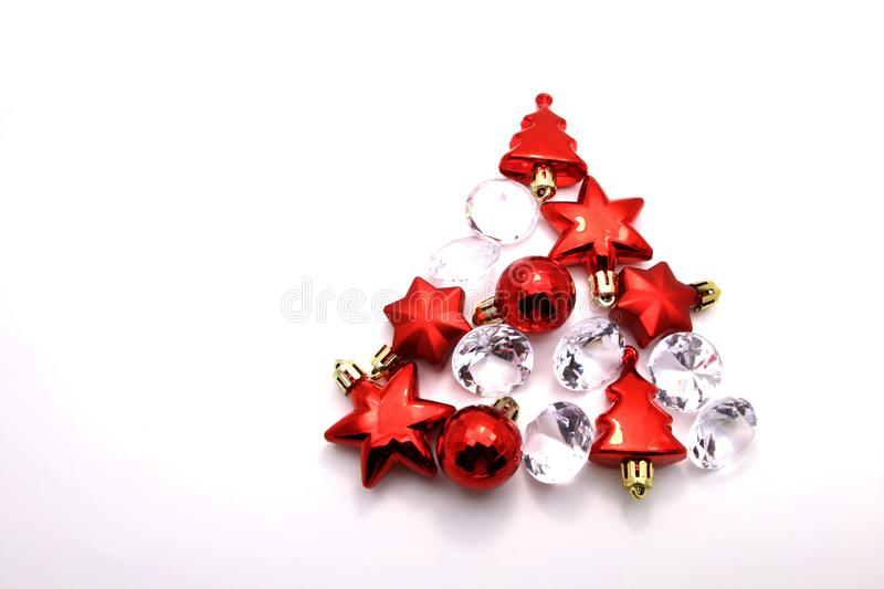 Christmas tree made from red winter decorations on white background with empty copy space for text. holiday and celebration. Creative concept. new year and vector illustration