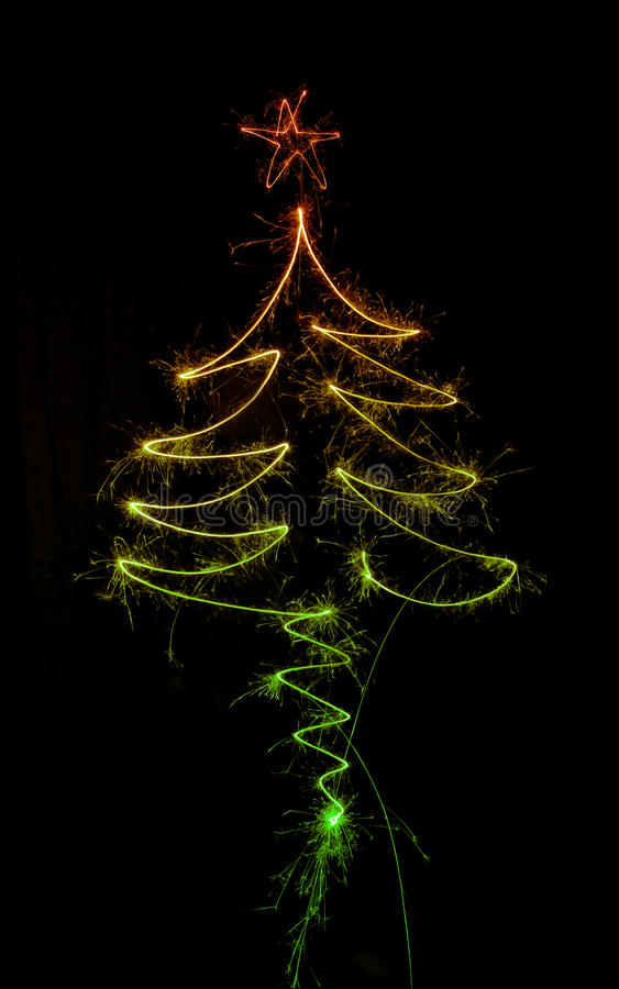 Christmas tree made by sparkler on a black royalty free illustration