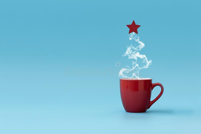 Christmas tree made of steaming coffee with red star. Morning drink. Christmas or New Year celebration concept. Copy space.  stock images
