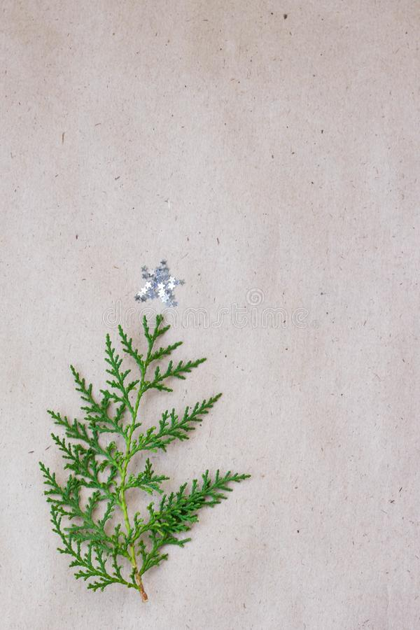 Christmas tree made of thuja branches and decorations star on rustic background. new year concept. Flat lay, top view stock photo