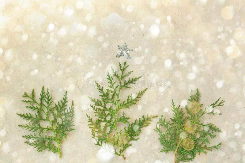 Christmas tree made of thuja branches and decorations star on rustic background. new year concept. Flat lay, top view stock photos