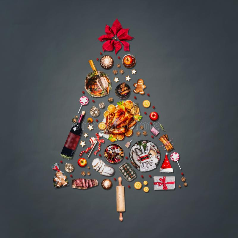 Christmas tree made with various Christmas food nd candies, cookies , mulled wine, gingerbread man decorated with gift box and po. Christmas tree made with stock images