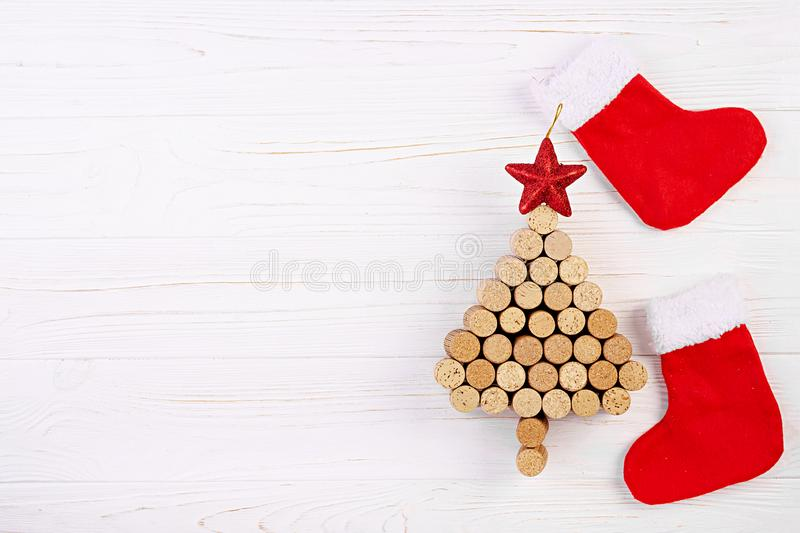 Christmas tree made of wine corks on white background. Mockup postcard with Christmas tree and copy space for text. Top view.  stock photo