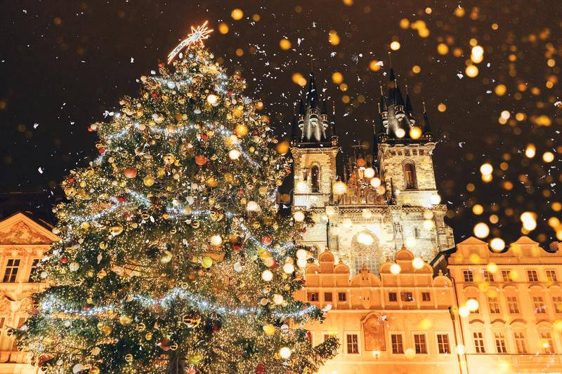 Christmas tree on the main square in Prague. Bokeh from lanterns stock image