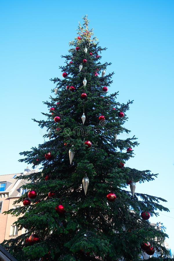 Christmas tree with red balls and silver cones in Dusseldorf royalty free stock photography