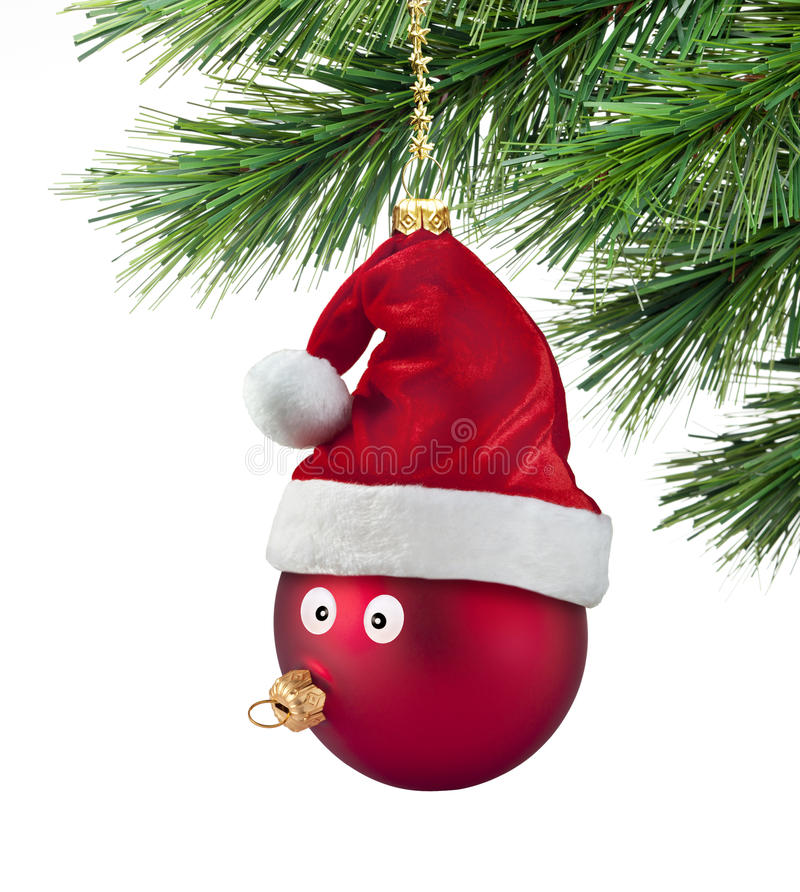 Christmas Tree Ornament Fun Tacky Funny. A christmas ornament with a face and santa hat hanging from a christmas tree stock photo