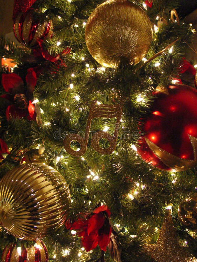 Christmas Tree and Ornaments. Close-up of Christmas Tree with red and gold ornaments and lights