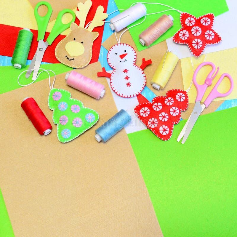 Christmas tree ornaments crafts. Felt Christmas tree, star, snowman, deer crafts, colored thread set, felt sheets, needles royalty free stock photography