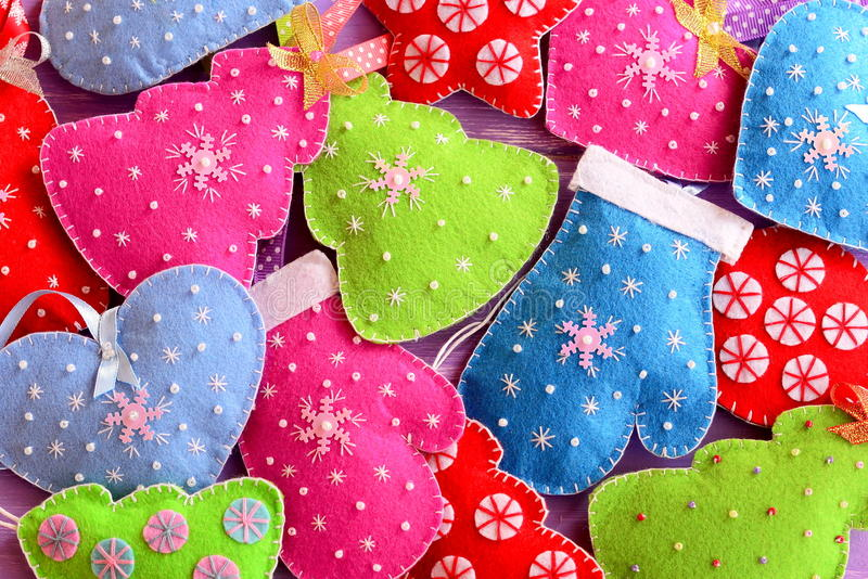 Christmas tree ornaments. Kids winter background. Cute felt Christmas trees, hearts, stars, mittens toys embellished with beads stock image