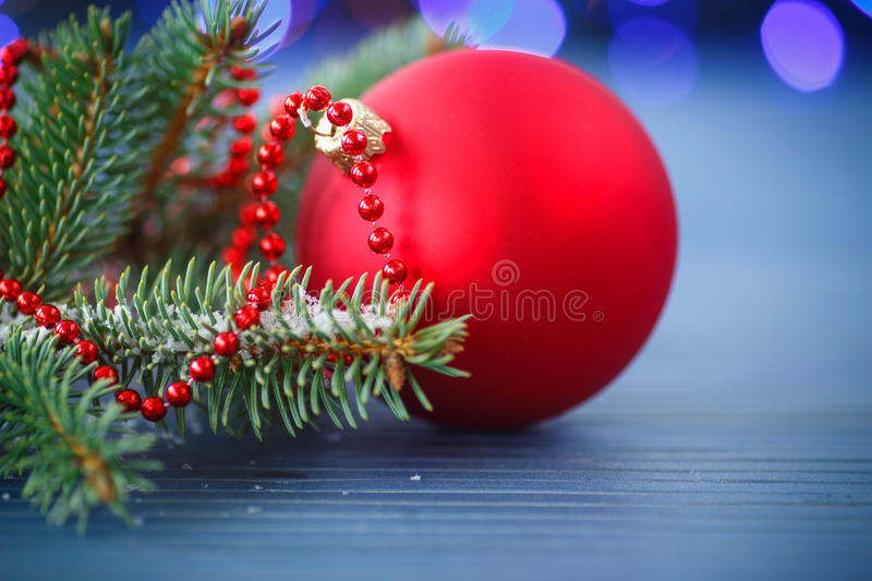 Christmas tree with ornaments. On the wooden table royalty free stock photography