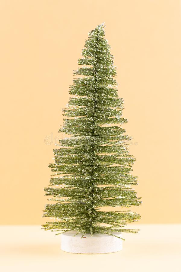 Christmas tree on pastel colored background. Christmas or New Year minimal concept stock image