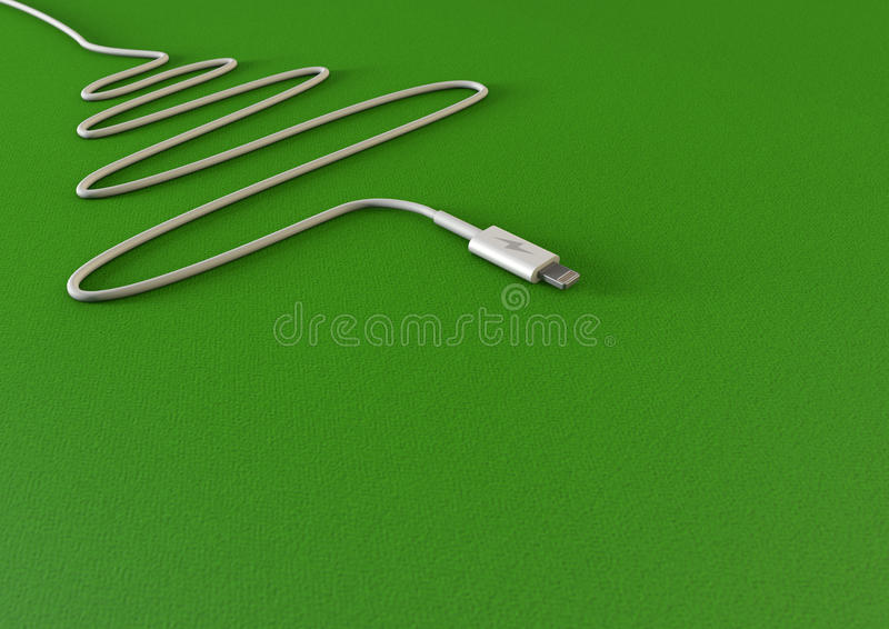 Christmas Tree Phone Charger. A mobile phone charger draped in the shape of a christmas tree on an green background with copy space royalty free stock photography