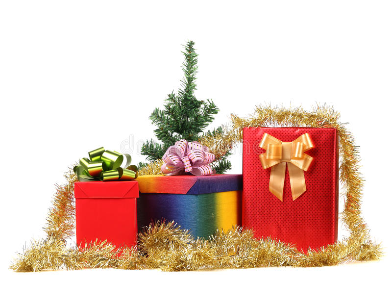 Christmas tree with present boxes. Isolated on a white background stock photo
