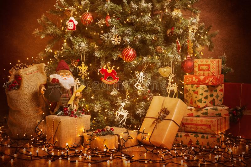 Christmas Tree and Present Gifts, Xmas Holiday Scene, Hanging Lighting and Toys royalty free stock photo