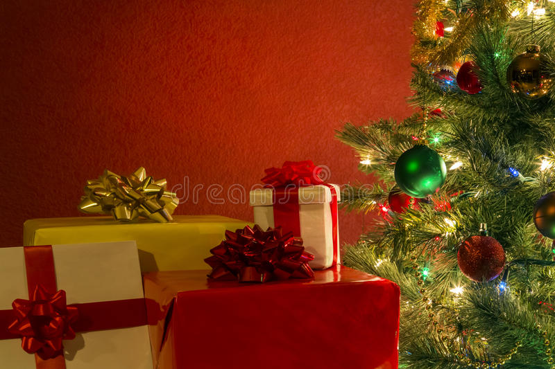 Christmas tree with presents stock photos