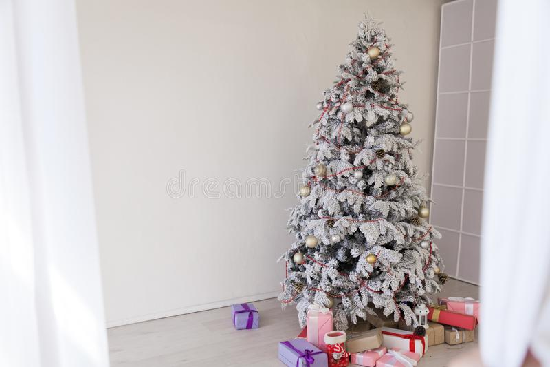 Christmas tree with presents new year white scenery. 1 stock photo