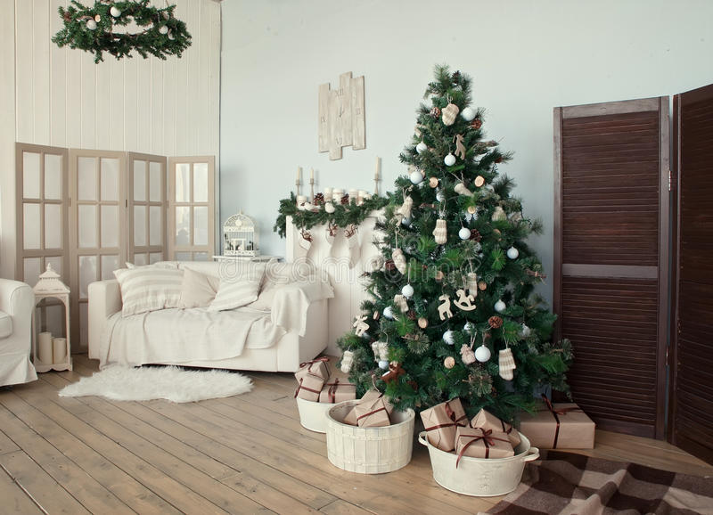 Christmas tree with presents underneath in living room stock images