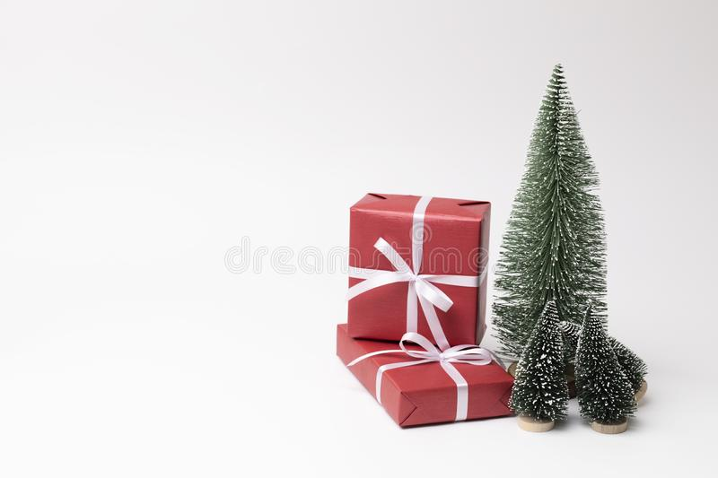 Christmas tree and presents on white background royalty free stock photo