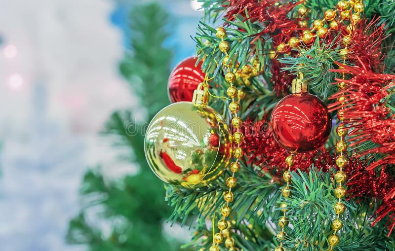 Christmas tree with red and yellow Christmas balls, beads and tinsel stock images
