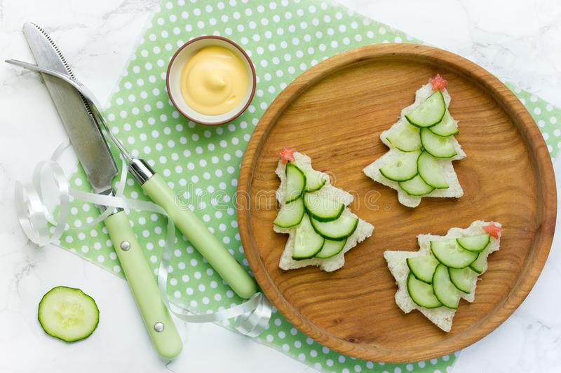 Christmas tree sandwiches with cucumber slices for festive xmas. Snack top view stock images