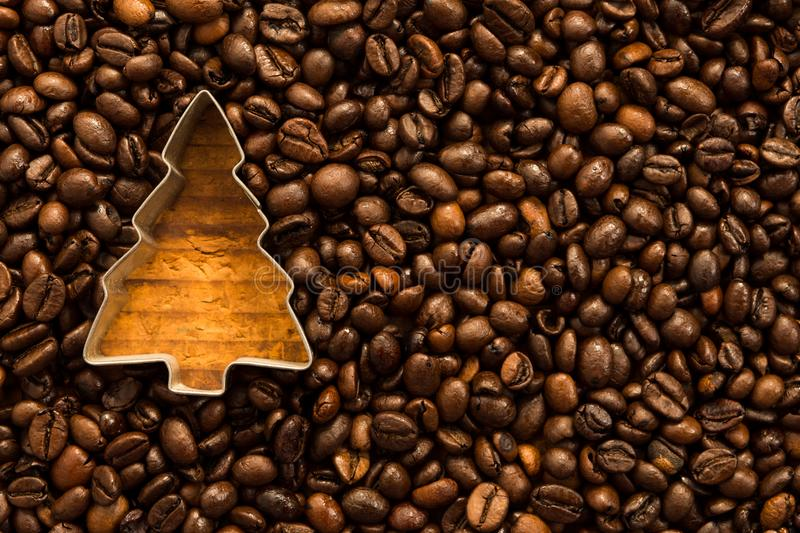 Christmas tree shape in coffee beans. As xmas holiday aroma concept royalty free stock photography