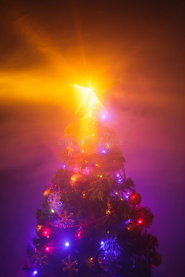 Christmas tree with shining star and smoke. Christmas tree with shining star and dense smoke royalty free stock photos