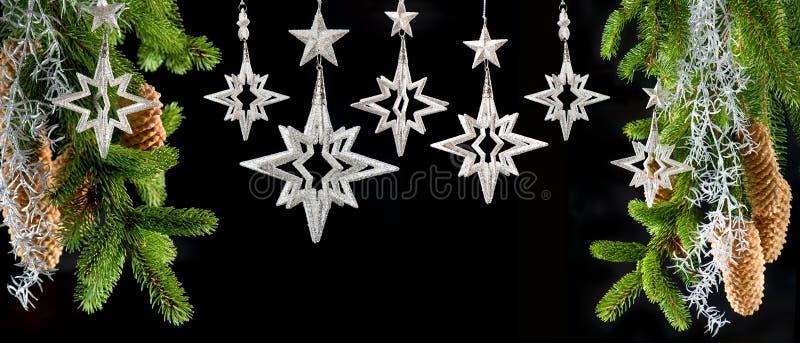 Christmas tree with shiny silver stars royalty free stock photography