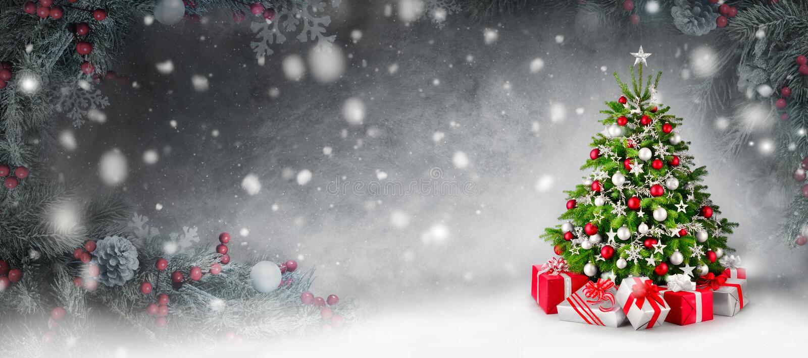 Christmas tree and snow background framed by fir branches stock images